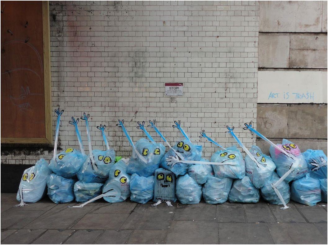 garbage painted to look human monsters faces francisco de pajaro london banksy brick lane 1