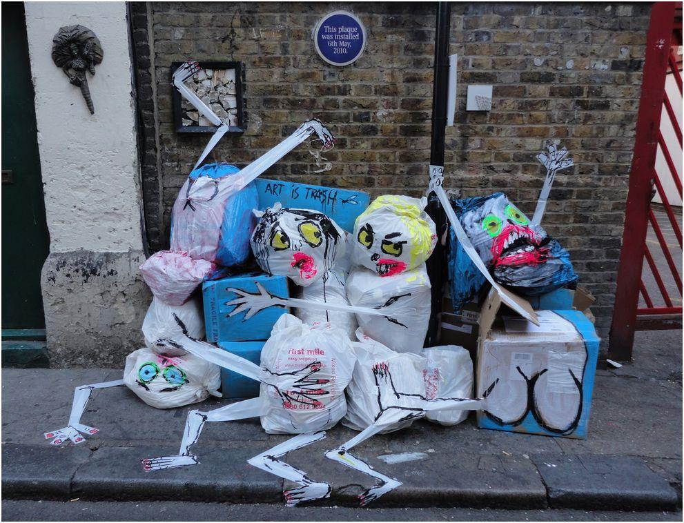 garbage painted to look human monsters faces francisco de pajaro london banksy brick lane 13